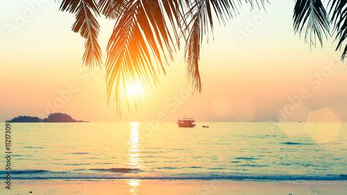 Sunset at tropical sea coast.