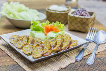 "Asgaew Hors d'oeuvres food Northern style tradition Thai cuisine menu what we call ""Sai Oua"" in Thai with herbs fried sausage sour pork, chili youth delicious food in Chiangmai province Thailand."