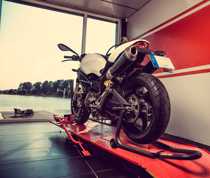 New sport motorcycle in a garage.