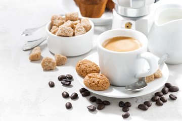 cup of espresso and cookies on a white table