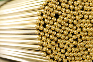 Close up on ends of brass rods