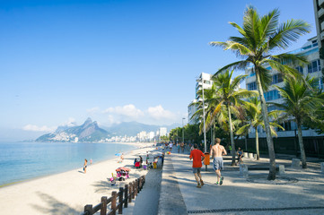 Early morning view of an empty Ipanema Beach from the shadows of Apoador in Rio de Janeiro, Brazil