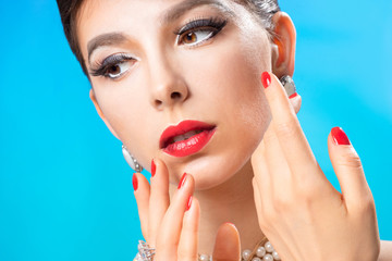 Beautiful makeup and manicure of young woman