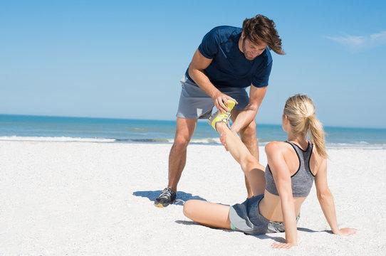 Trainer helping runner