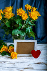 bouquet of roses and picture frame