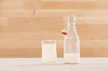Milk bottle and full glass