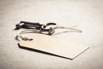 Blank key tag. Concept of a new home, vintage lifestyle and nostalgia.