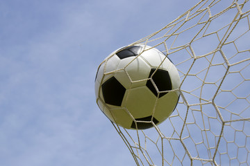 foot ball in the goal net