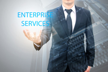 Double exposure of businessman with servers technology in datacenter in IT enterprise services concept