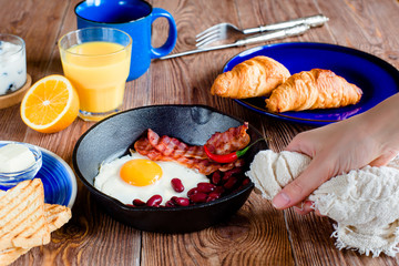 english breakfast in rustic style. first person view