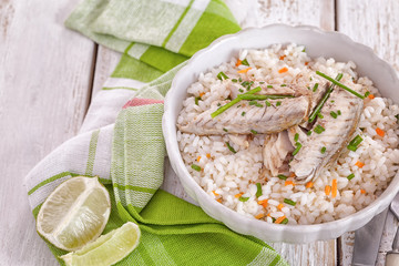 Grilled fillet of herring on rice