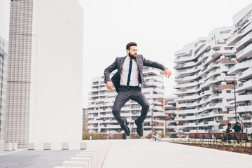 Young contemporary businessman jumping