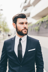 Young businessman standing outdoors