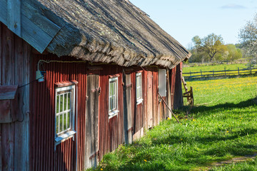 Wall Mural - Old weathered barn with thatched roof