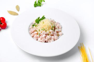 Spaghetti carbonara on a white background