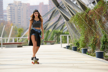 Young skater woman at the city