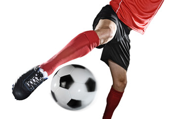 close up legs and soccer shoe of football player in action kicking ball isolated on white background