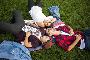 Friends laying in grass