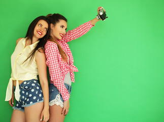best friends hipster girls standing together with photo camera