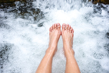 rest relaxing foot in waterfall in tropical forest
