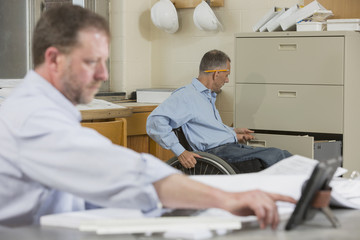 Caucasian architects working in office