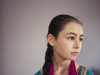 Close up of serious mixed race girl