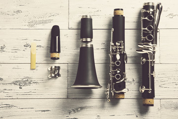 disassembled clarinet / overhead of a disassembled clarinet on wood top