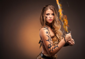 Beautiful woman with sword . Fantasy and legend. Standing in fighting stance.