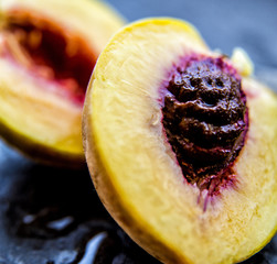 Close up of sliced peach and stone
