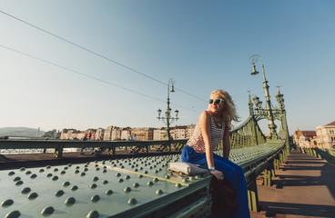 Caucasian woman sitting on bridge