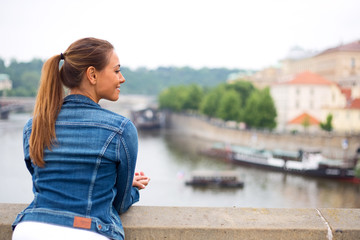 young woman enjoying the view from a bridge
