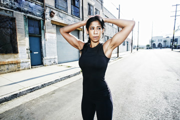 Mixed race woman stretching outdoors