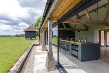 Open-air kitchen and backyard in modern home