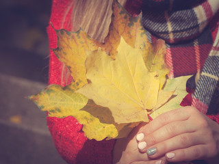 Lady with autumnal leaf.