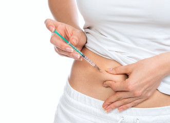 Medical diabetes insulin syringe injection shot into abdomen wit