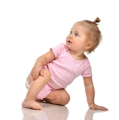 Six month infant child baby toddler sitting in pink body and dia