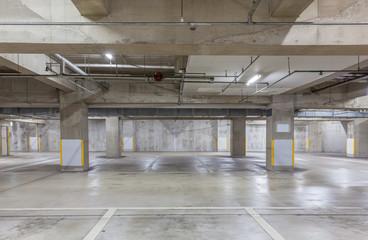 Parking garage underground interior with neon lights , Empty Parking lot , Car park at underground building ..