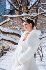 Bride in the winter against the backdrop of New York