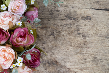 Rose flowers on rustic wooden background. Copy space. Wall mural