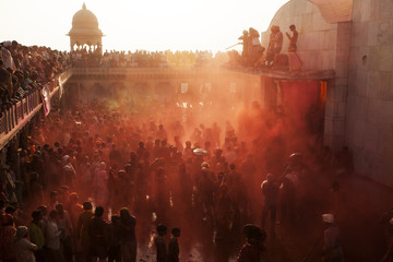 Holi festival enjoying by a crowd in Krishna Temple of Uttar Pradesh,India
