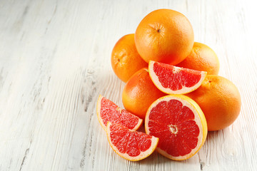 Juicy grapefruits on wooden background