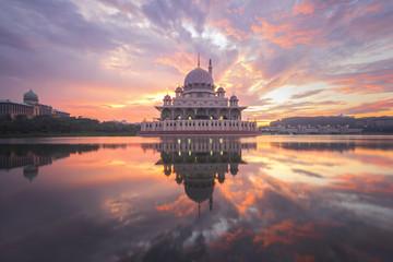Putra Mosque and Perdana Putra in Putrajaya with burning sky at the sunrise
