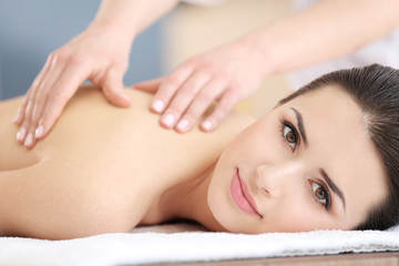 Young woman having massage in spa salon