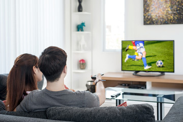 Sport, football, People concept - Young Asian couple waching foo