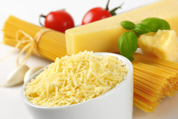 parmesan cheese and uncooked spaghetti