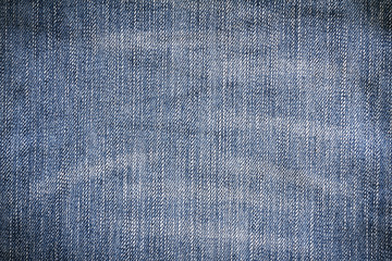 Denim texture. Denim background. Denim jeans. Denim fabric. Denim Surface. Blue jeans. Jeans texture. Jeans background. Jeans fabric. Jeans textile. jeans Surface. Jeans detail. Dark edged.