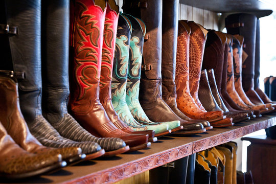 Cowboy boots store shelves. Handmade leather boots