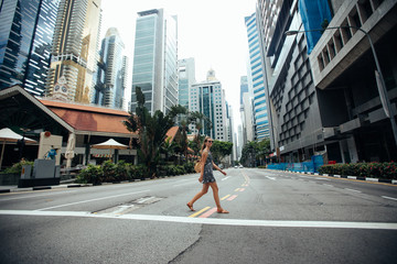 Singapore travel tourist woman on vacation  walking among the sk