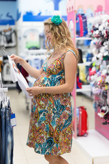 young pregnant woman in baby shop
