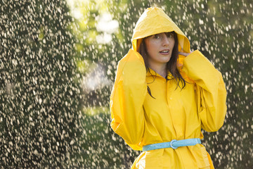 Woman in yellow raincoat  out in the rain